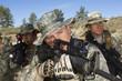 Soldiers aiming machine guns