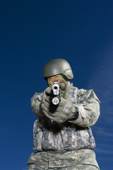 Portrait of soldier aiming to camera