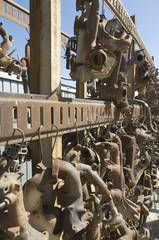 Rusty car parts on rack