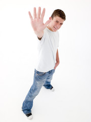 Teenage boy standing with hand up smiling