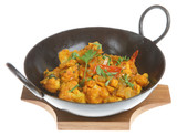 Cauliflower Bhahji in an authentic korai serving dish poster