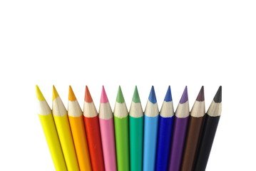 different colourful sharpened crayons on white background