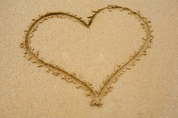 Heart drawn on sand for the day of St. valentine