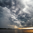 View of thunderstorm clouds above water - 8819024