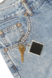 Denim pocket with a key tag hanging out