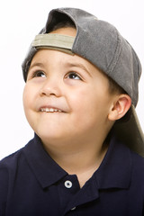 Young latino boy wearing baseball cap