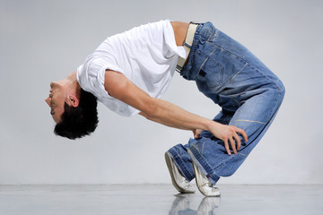 breakdancer posing on a grey background