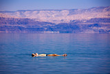 Fototapety Man floating at the Dead Sea, Israel