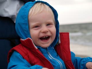 happy boy on the beach