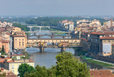 Cityscape of Florence in Italy with bridges across Arno river poster