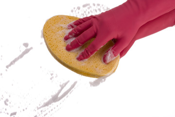 pink hand cleaning a mirror