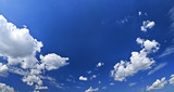 Panoramic background of blue sky with white cumulus clouds poster