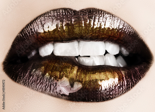 Woman biting her lips with black glossy lipstick