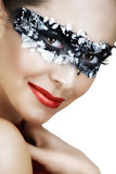 Beautiful woman with red lips and silver leaf mask