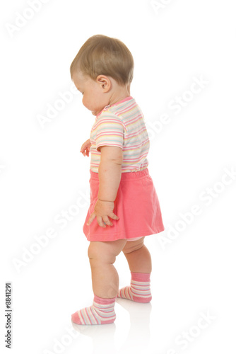 First steps of small baby in red dress #2 isolated