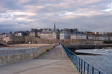 Strolling the pier in Saint Malo in late afternoon, France poster