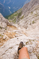 climbing on ferrata in julian alps, slovenia