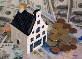 The model house on a banknotes background
