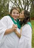 Two happy graduates wish each other luck in the future. poster