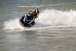 Man speeding on high performance jet ski