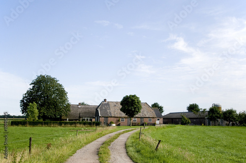 Landscape with farmhouse in the middle of the farmland