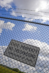 A no trespassing sign that reads STATE PROPERTY