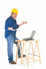 Carpenter at work with laptop