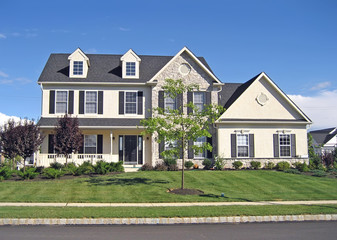 Front of a spacious, upscale suburban home.