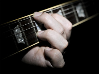 Guitar Player Playing Chords