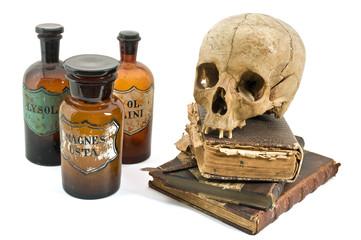 skull, old books, old drug bottles isolated on white