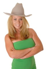 Isolated lovely and sexy young blond girl wearing a cowboy hat