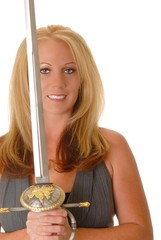 Isolated lovely and sexy young blond girl holding a sword