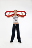 Young blonde woman with a flexible gym apparatus poster