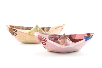 Ship made of money isolated on a white  background.