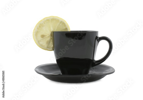 Black cup of coffee with lemon