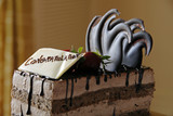 chocolate pastry cake with congratulations greeting poster