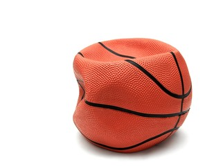 Soft, broken basketball isolated on white