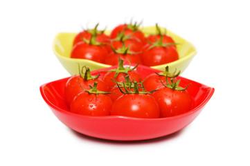 Wet whole tomatos isolated on white background