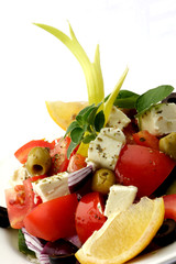 Greek salad on white plate