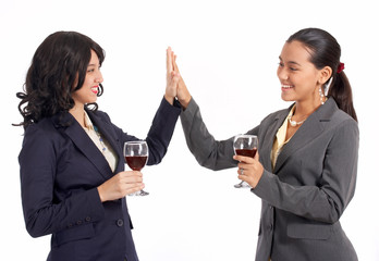 female businesspartners doing a high five gesture