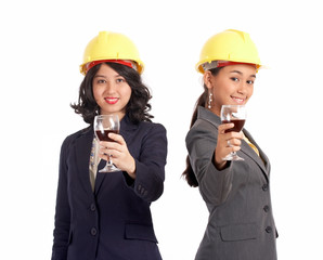 female business partner offering a glass of wine