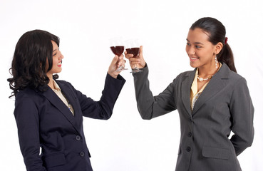 beautiful female co-workers doing a wine toast