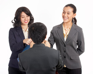 Businessman giving some reward to her female employees