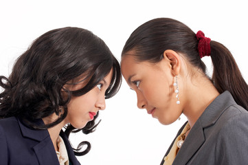 battle of two young female employees -  eye to eye