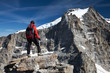 Hiker and landscape of Gran Paradiso peak (4046 mt), Italy