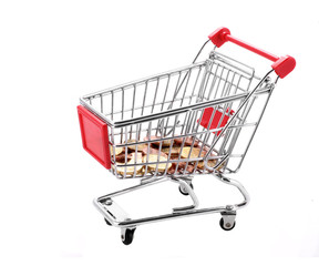 shopping cart with euro coins in it