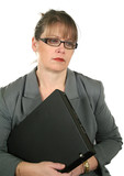 Businesswoman with laptop looking down in a dejected mood. poster