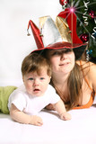 Brother and Sister with  fool`s cap at Christmas poster