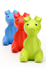 Green, Red, and blue piggy banks in a row.