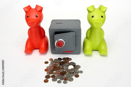 Red and Green Piggy banks guarding a combination safe.